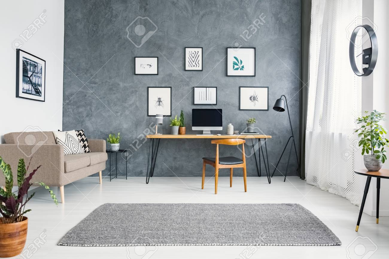 Sofa In Home Office Wooden Chair At Desk In Grey Home Office Interior With Sofa And