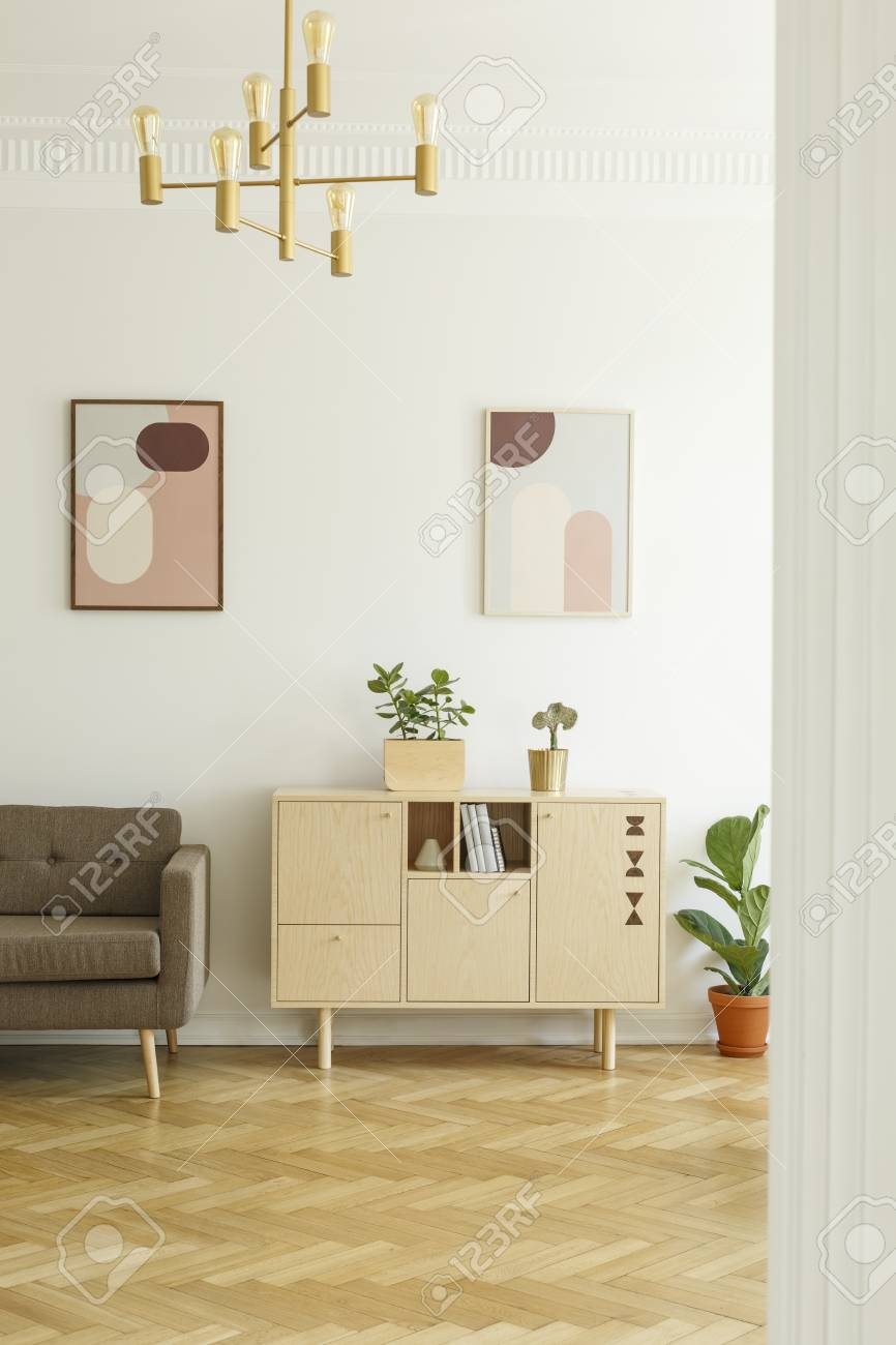 Retro Sofa Wood Posters On A White Wall Comfy Sofa And A Simple Wooden Cabinet