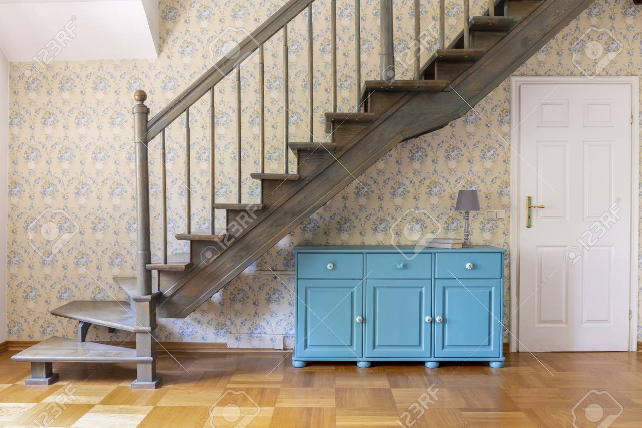 A Light Blue Three Door Cabinet Standing Under Gray Staircase Stock Photo Picture And Royalty Free Image Image 107758667