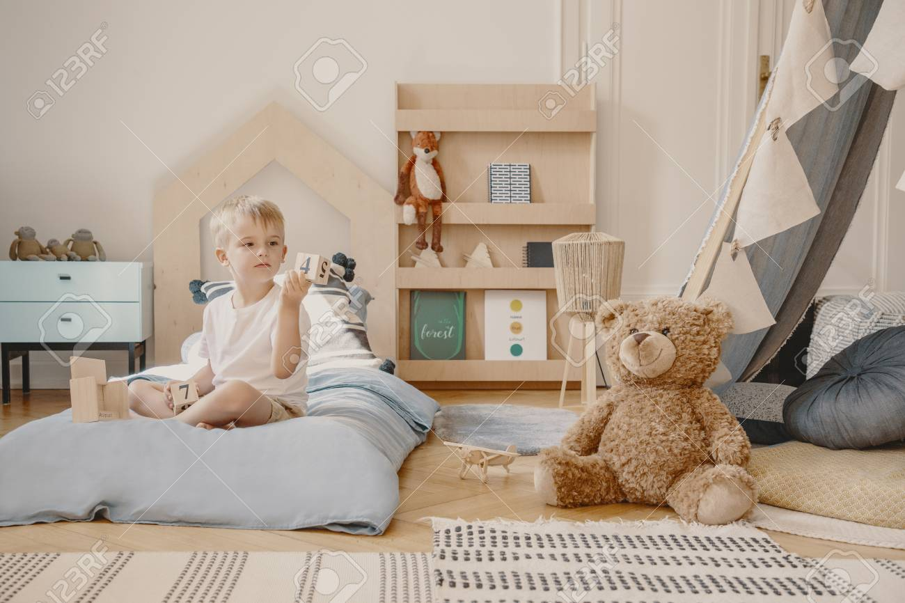 Scandinavian Furniture Bed Teddy Bear Next To Boy On Blue Bed In Scandinavian Bedroom Interior