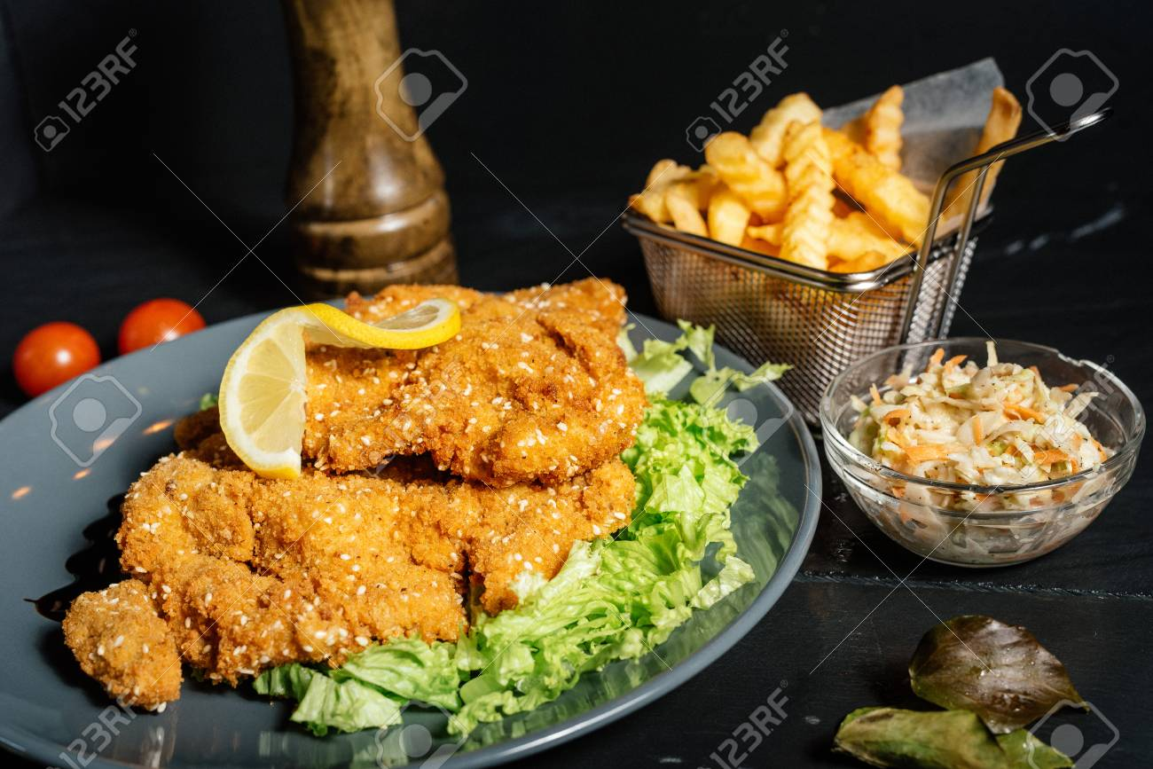 Schnitzel Restaurant Delicious Mouth Watering Schnitzel Served With French Fries At