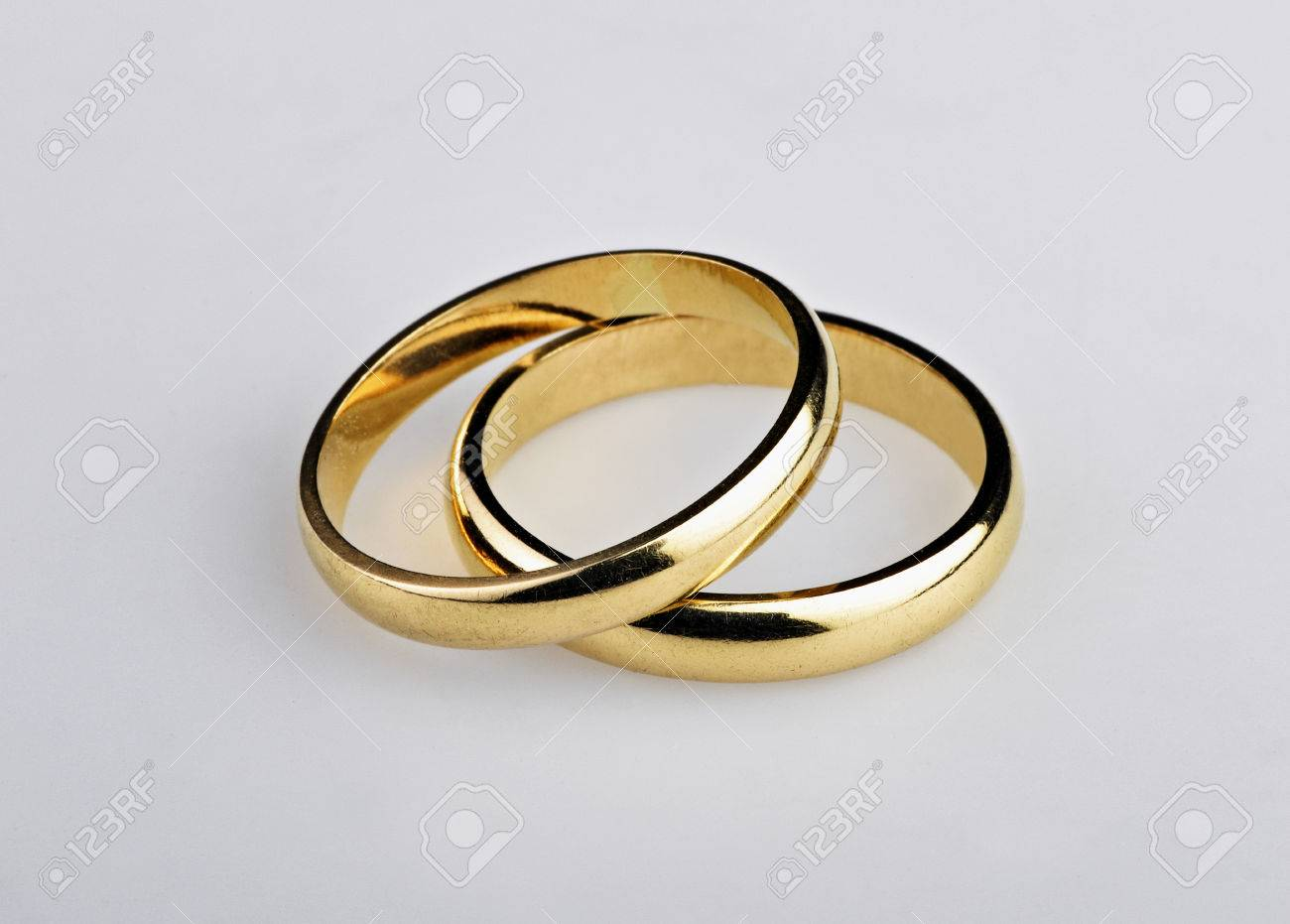 used golden wedding rings on gray background download - Used Wedding Rings For Sale