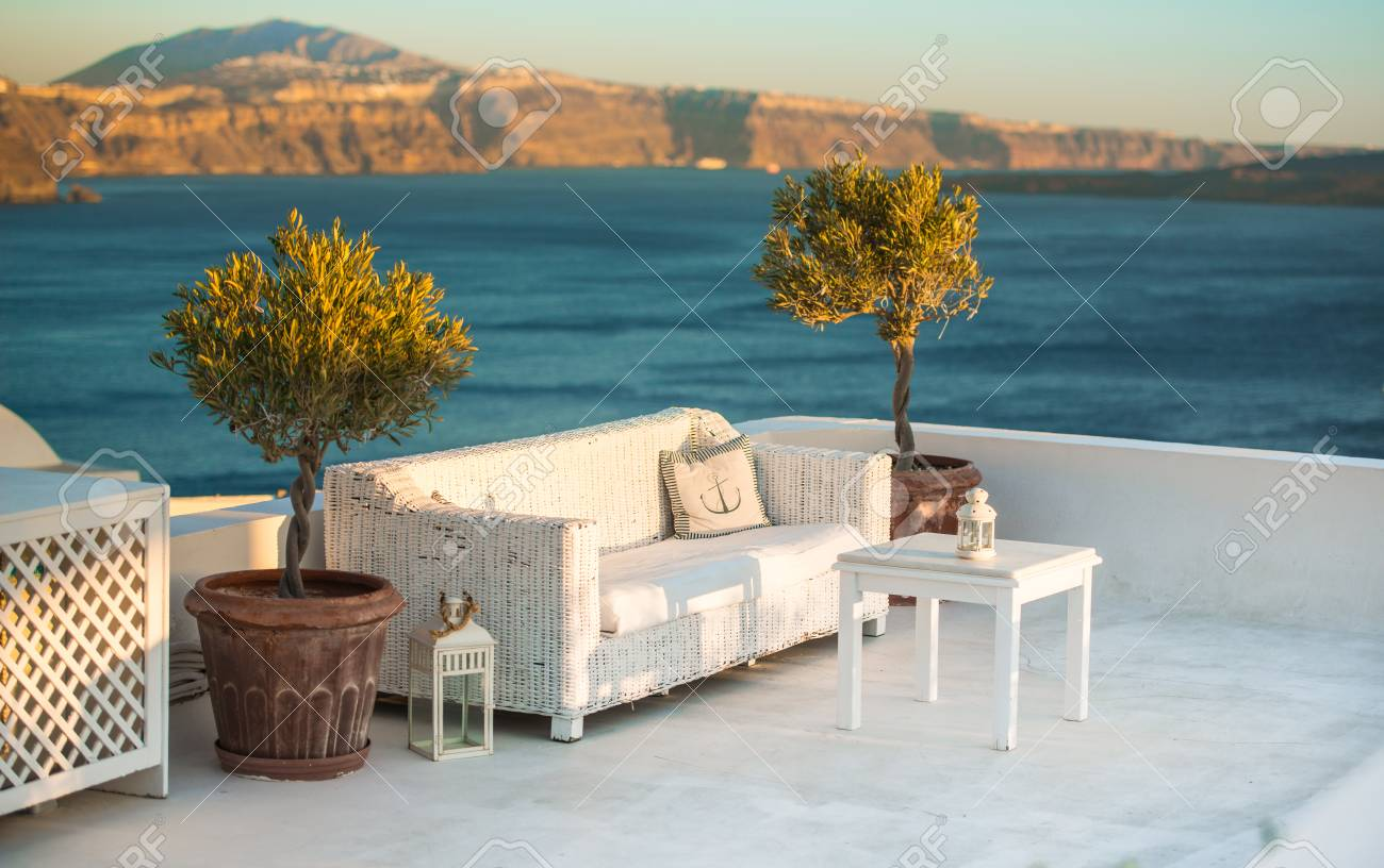 Outdoor White Table And Sofas On Terrace Overlooking Sea Oia Stock Photo Picture And Royalty Free Image Image 69021557