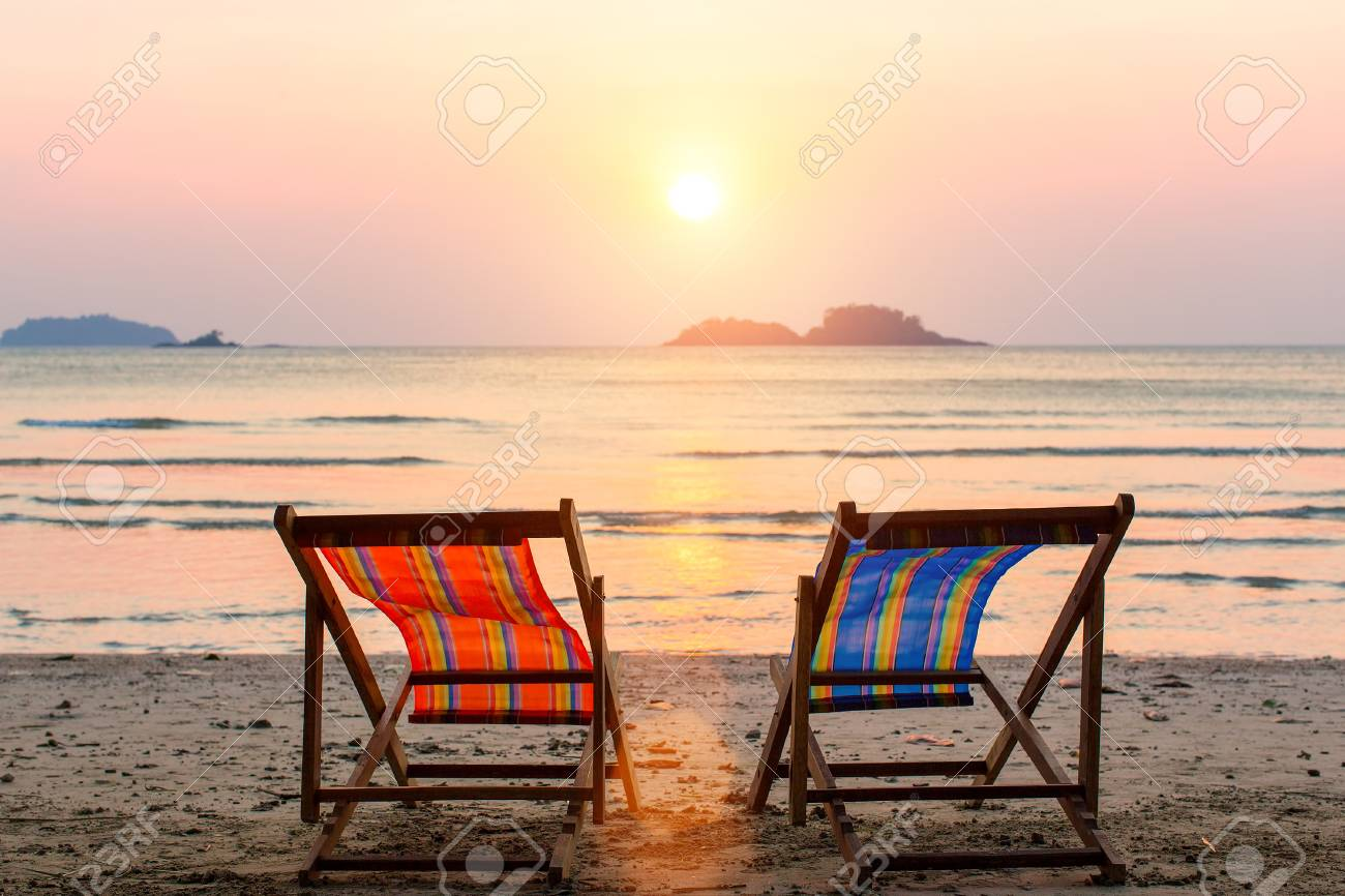 Two Lounge Chairs On Sunset Beach Stock Photo Picture And Royalty Free Image Image 57053799
