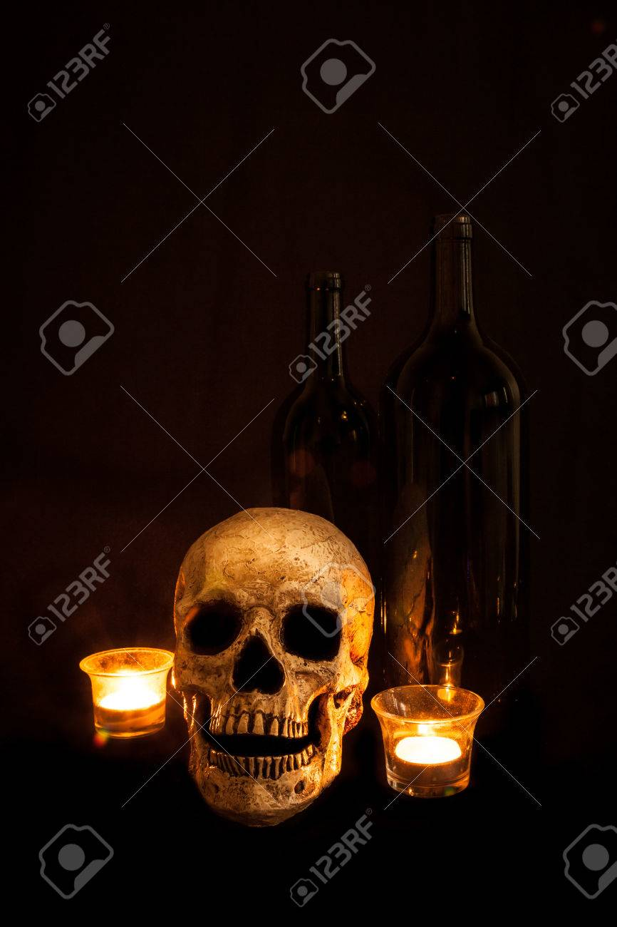 Candle Light Painting A Vintage Skull Sits Beside Two Wine Bottles Image Lit By Candlelight
