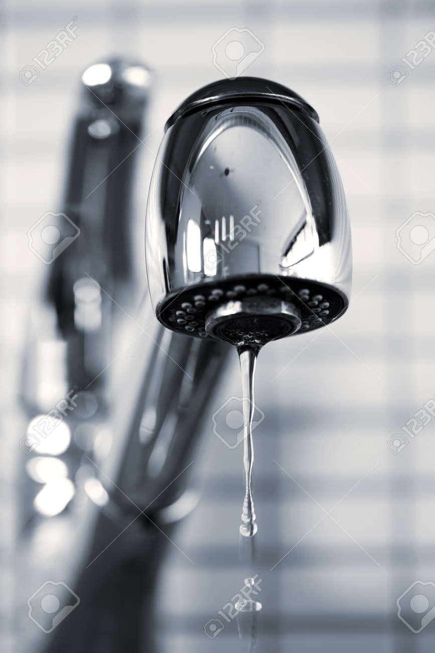 photo water dripping from stainless steel kitchen faucet leaking kitchen faucet Stock Photo Water dripping from stainless steel kitchen faucet