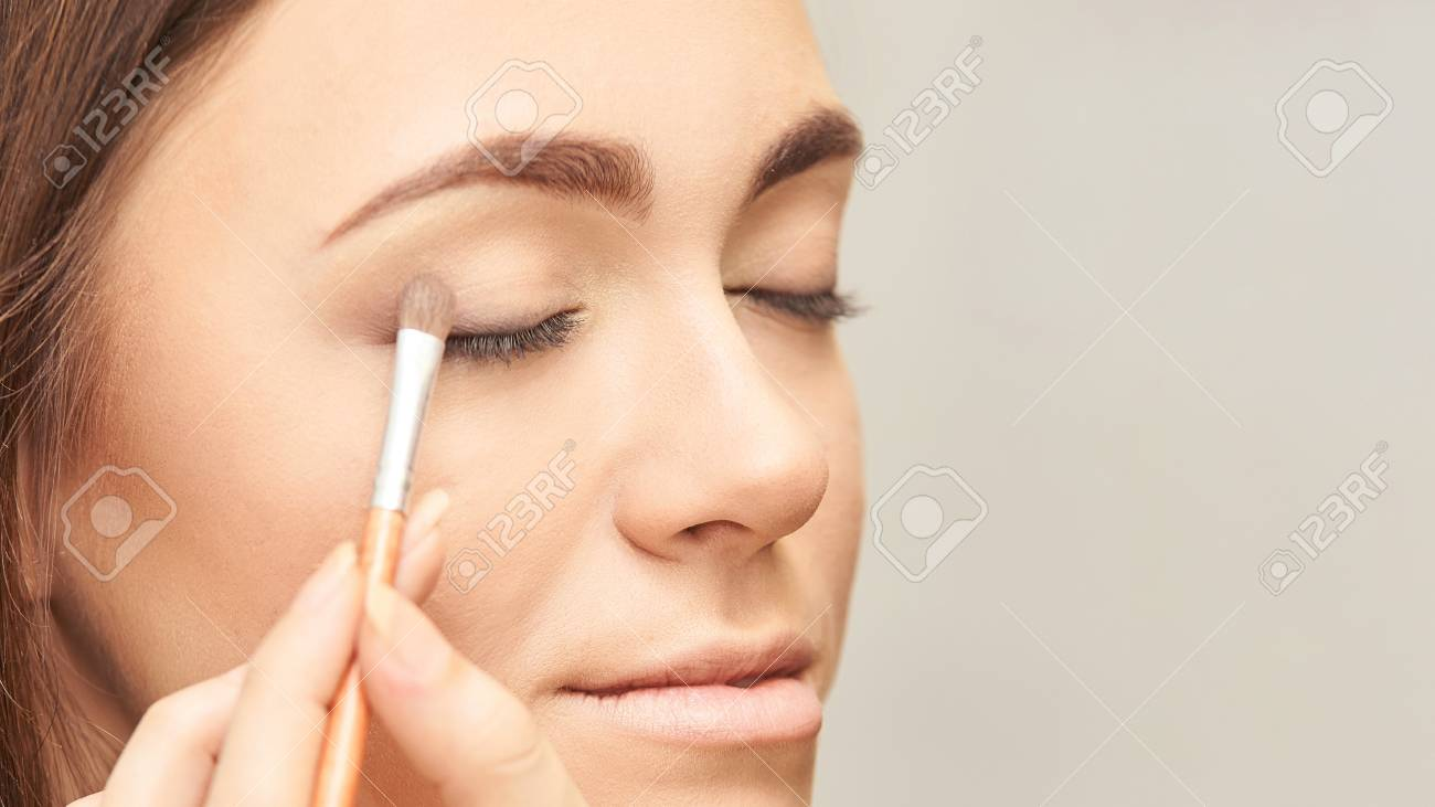Nude Look Makeup Professional Artist Apply Face Mascara. Woman Beauty Model... Stock Photo, Picture And Royalty Free Image. Image 114856588.