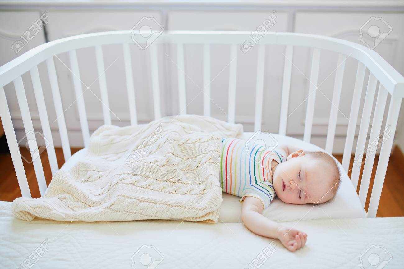What Can Baby Sleep In Next To Bed Adorable Baby Girl Sleeping In Co Sleeper Crib Attached To Parents