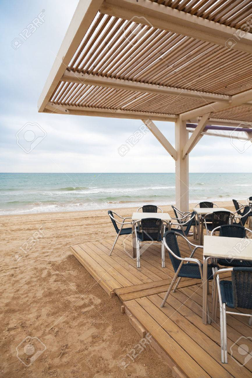 Metallsessel Sea Side Bar Interior With Wooden Floor And Metal Armchairs On