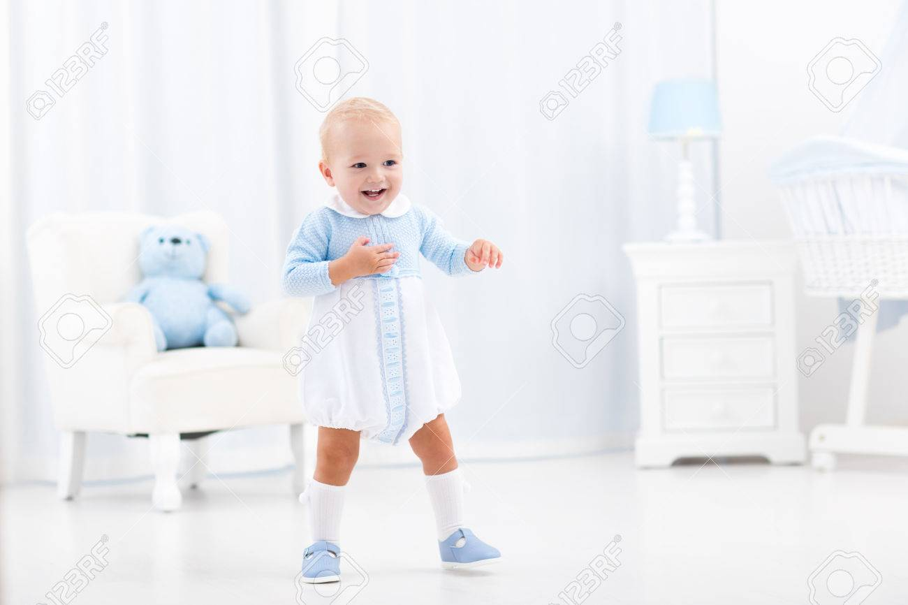 Infant Learning Chair First Steps Of Baby Boy Learning To Walk In White Sunny Bedroom