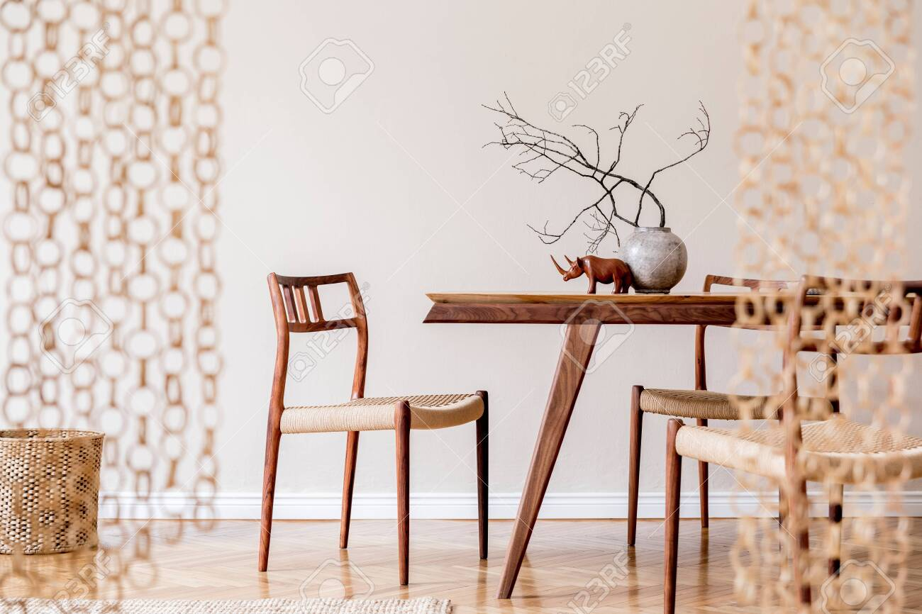 Stylish And Beige Interior Of Dining Room With Design Wooden Stock Photo Picture And Royalty Free Image Image 150644407