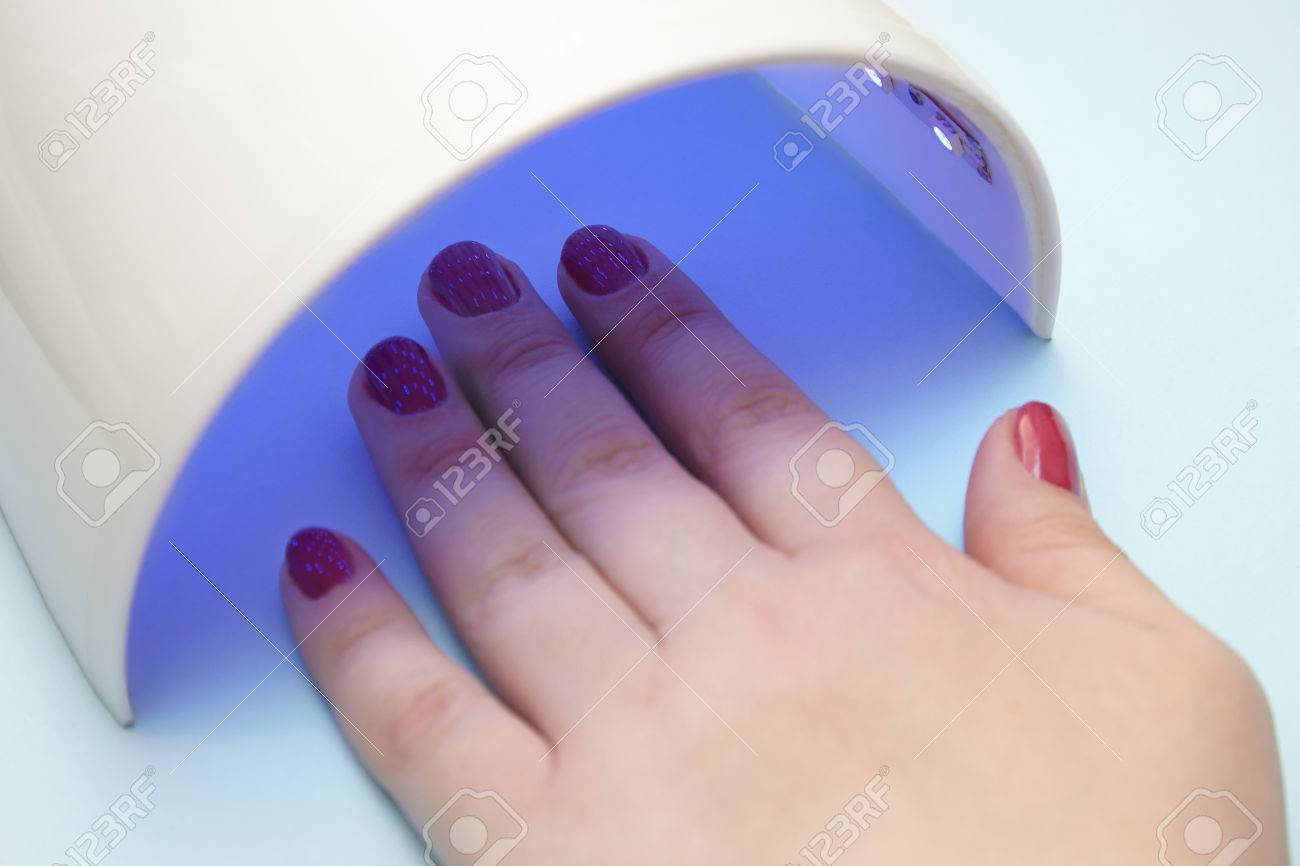 Ultraviolet Lamp Varnish On The Nails The Ultraviolet Lamp Dries The Gel Lacquer