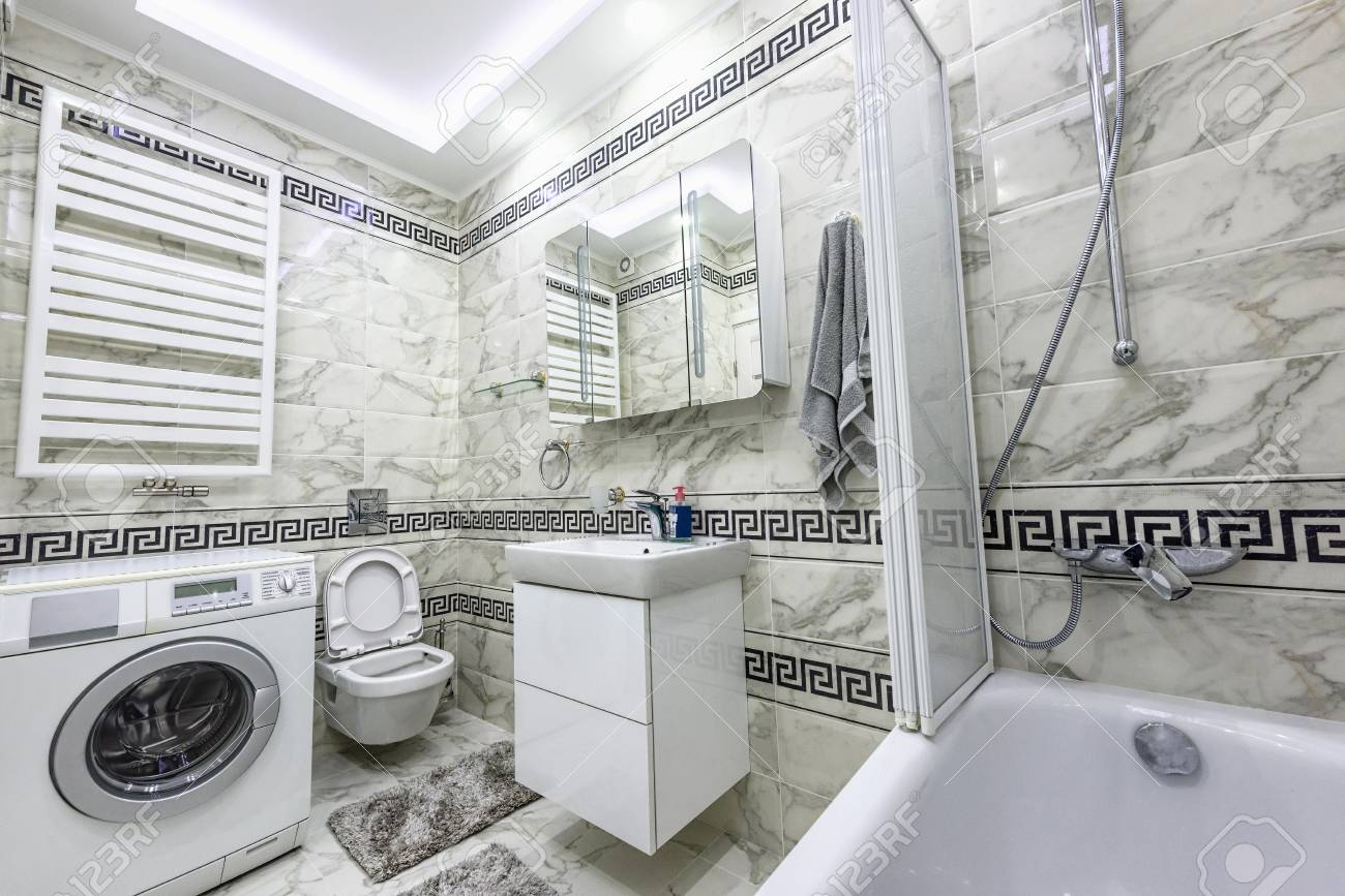 Stock Photo White And Black Small Bathroom With Washing Machine Stock Photo Picture And Royalty Free Image Image 74287203