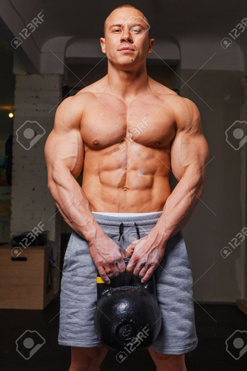 Kettlebell Bodybuilding Strong Muscular Man Bodybuilder Shows His Muscles Holding Kettlebell