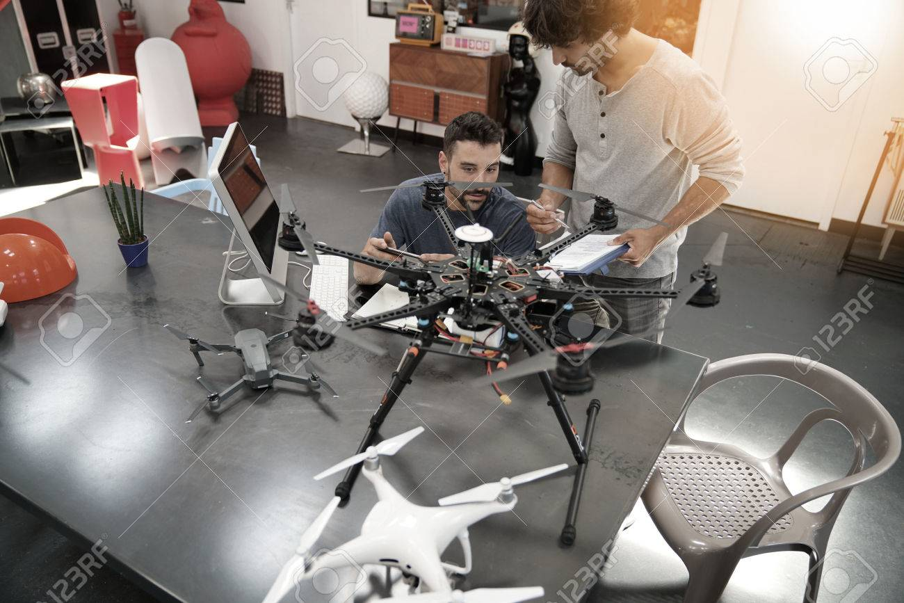 Salon Drone Engineer And Technician Working Together On Drone In Office
