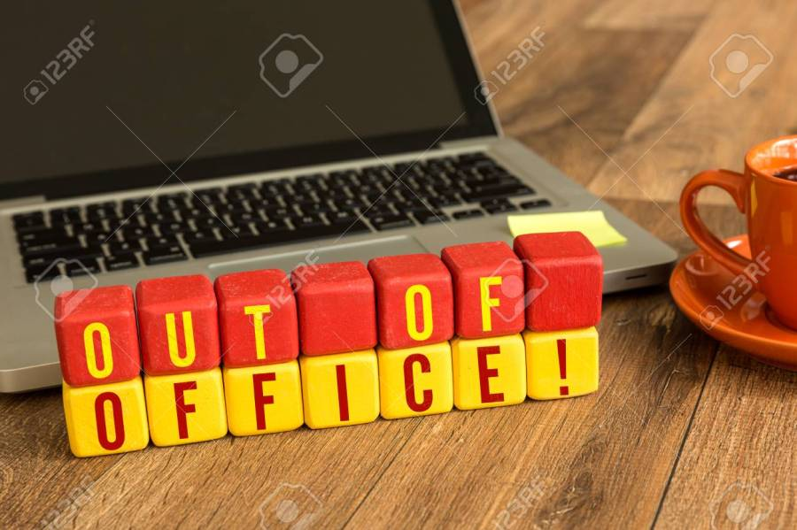 Out of office! written on a wooden cube with laptop background Stock Photo - 64665474