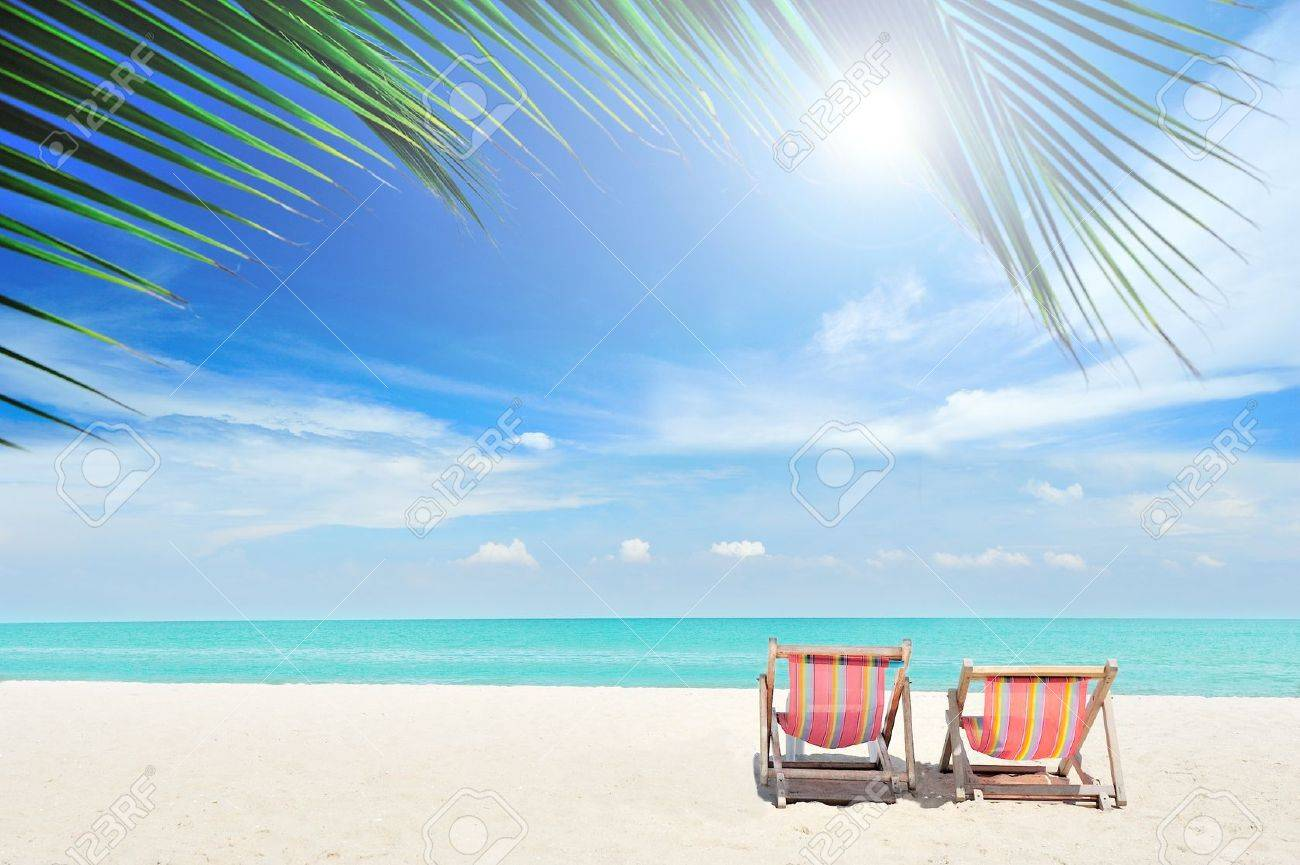 Beach Chairs On The White Sand Beach With Cloudy Blue Sky Stock Photo, Picture And Royalty Free Image. Image 13056328.