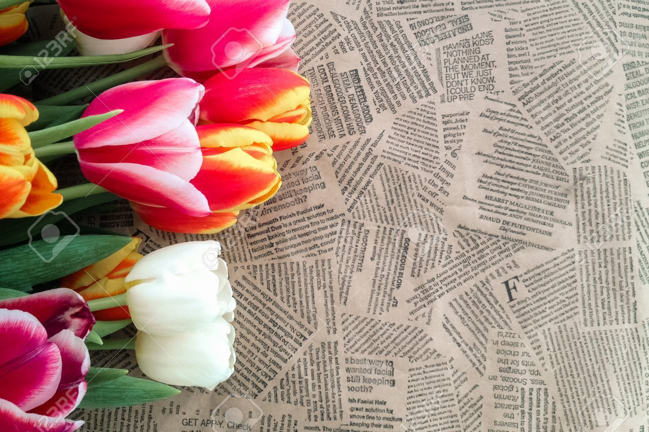 Vintage Bad Copy Tulips Flowers Bunch On Vintage Newspaper Background Empty Space