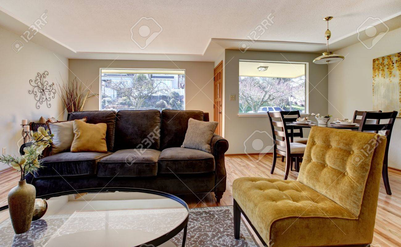 blue and yellow living room with brown couch