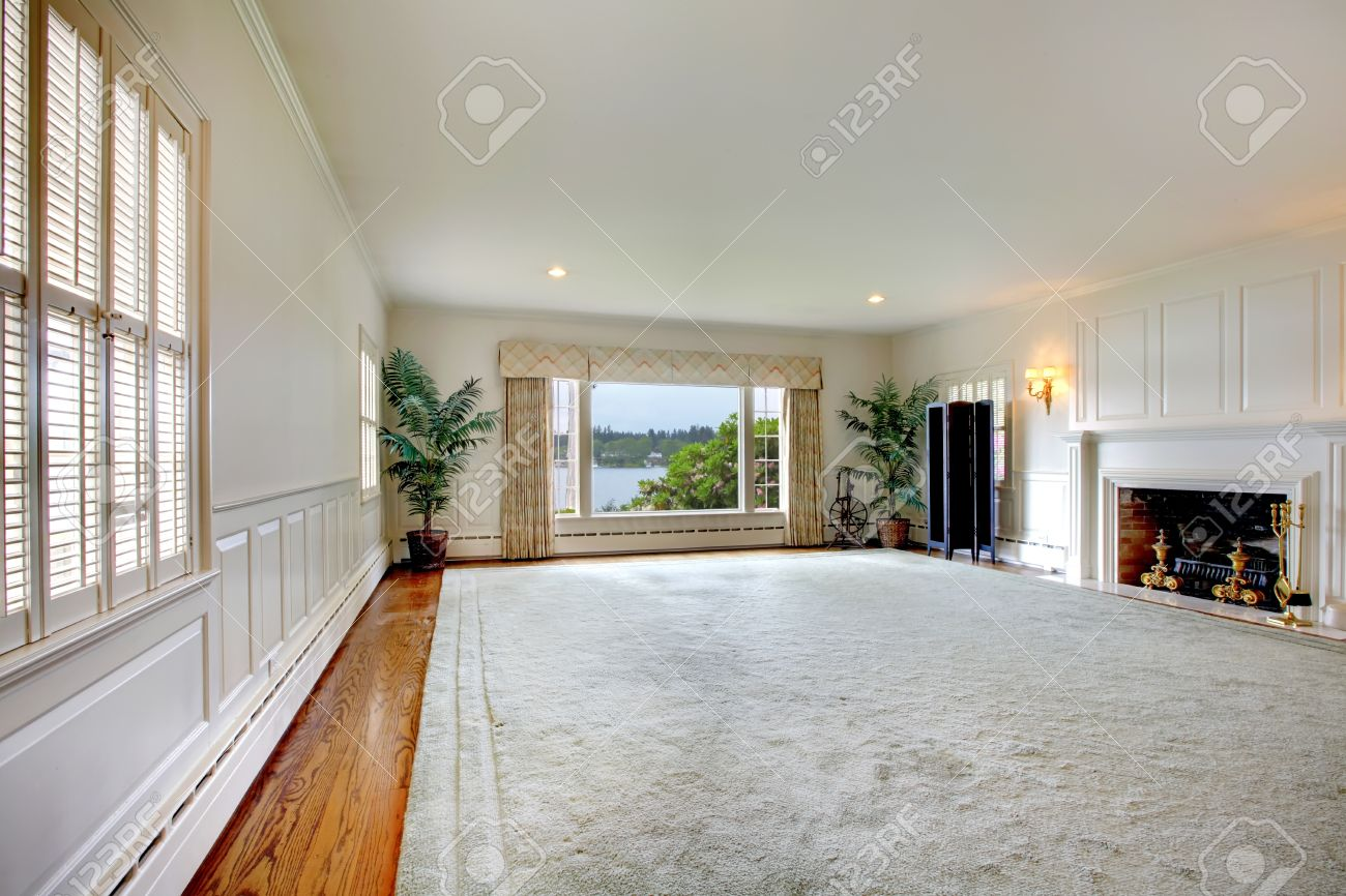 Huge Rugs For Living Room Large Empty Living Room With Huge Rug Fireplace And Lake View