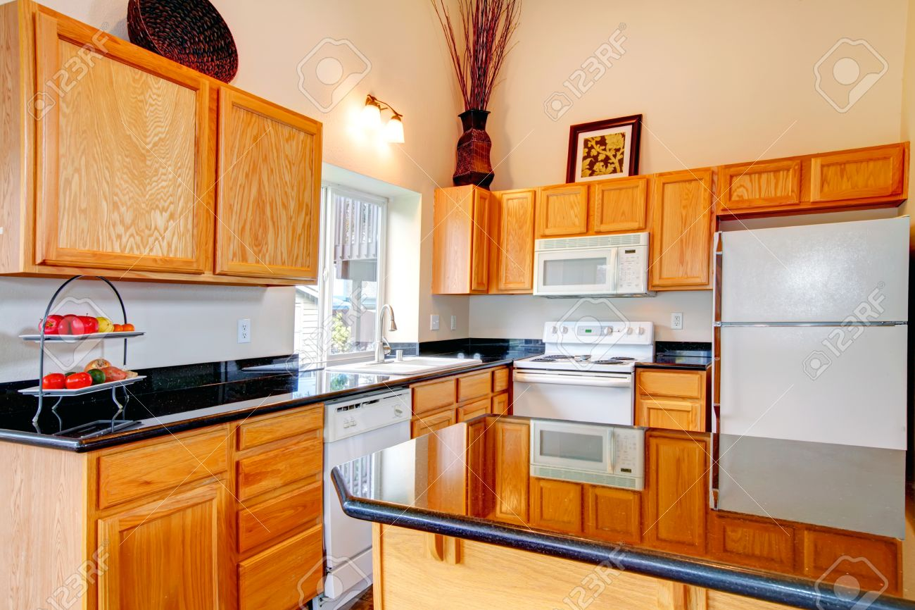 Black Kitchen Light Light Brown Cabinets With Black Counter Tops White Kitchen Appliances
