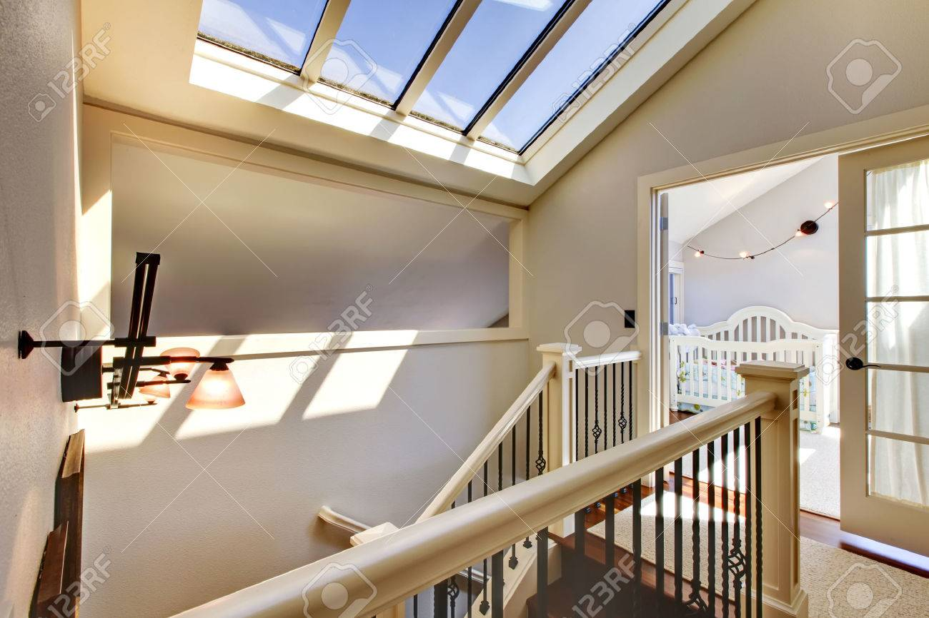 Lucernario En Ingles Staircase With Skylight And Baby Room In A Bright Hallway