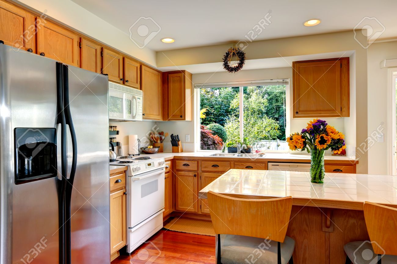 Cucina Kitchen Appliances Cozy Kitchen With Honey Color Cabinets White Appliances And