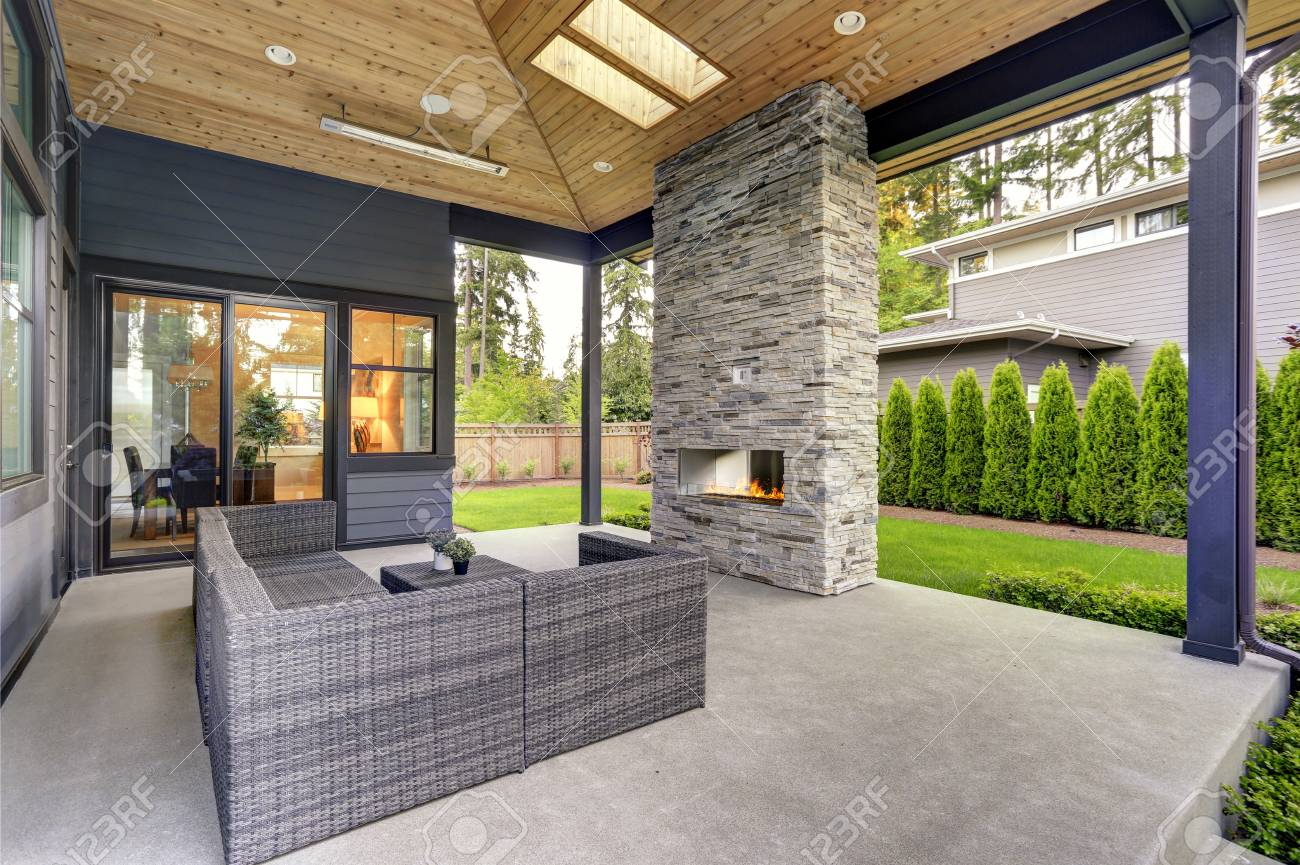 Patio Moderne New Modern Home Features A Backyard With Covered Patio Accented