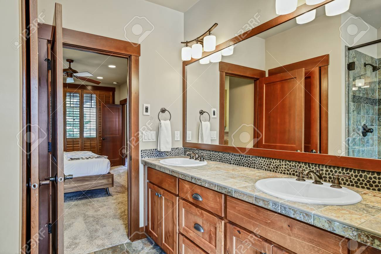 Master Bathroom With Double Sink Vanity Cabinet And Wood Framed Stock Photo Picture And Royalty Free Image Image 108426767