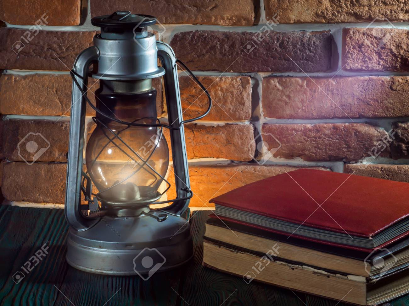Modern Kerosene Lamp Still Life Kerosene Lamp Shines On Wooden Desktop Stone Brick