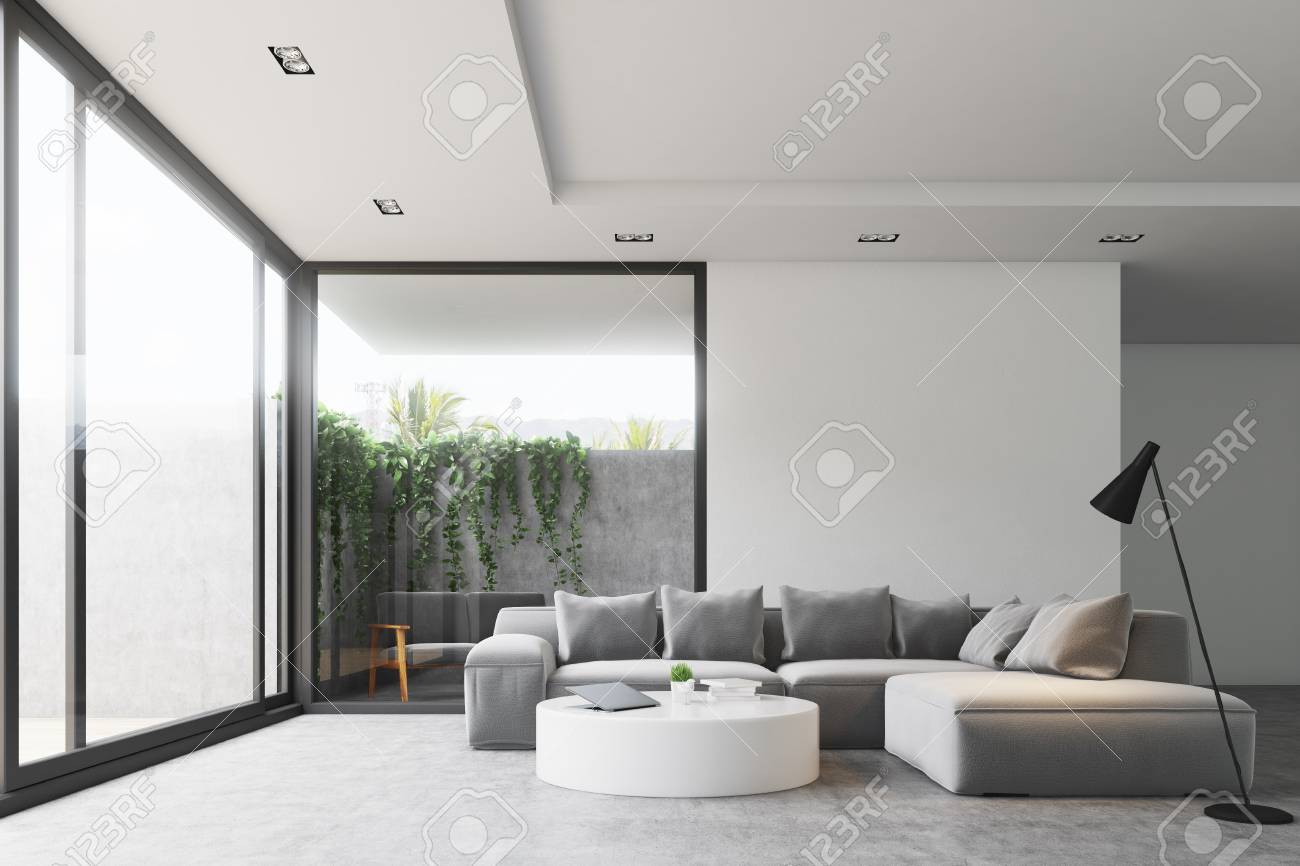 Gray Sofas For Living Room Living Room Interior With A Concrete Floor A Gray Sofa A Round