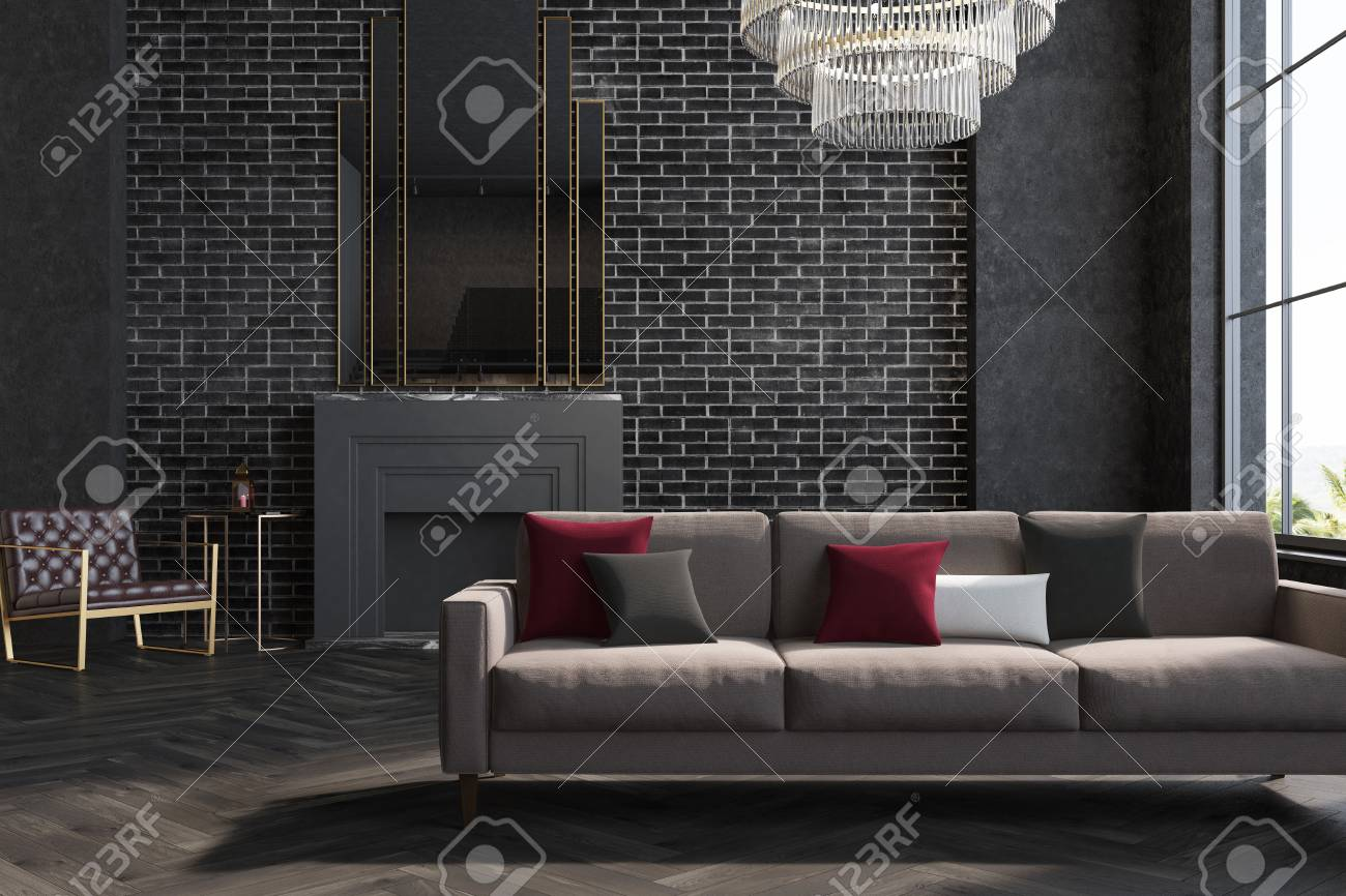 Gray Sofas For Living Room Black Brick Living Room Interior With A Gray Sofa And Armchair