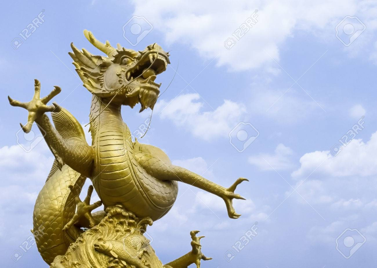 Giant Dragon Statue Giant Powerful Golden Dragon Statue At The Corner With Blue Sky