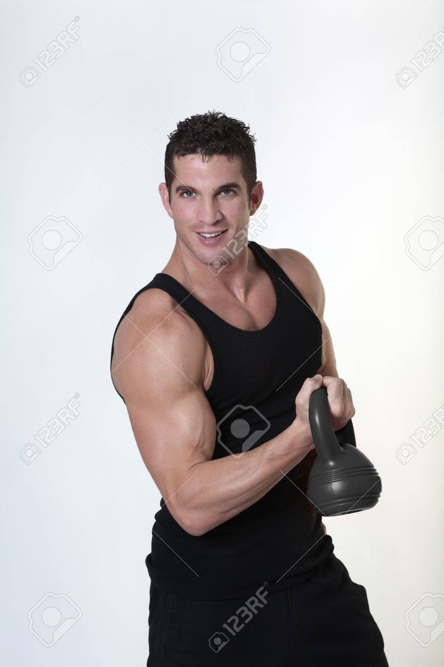 Kettlebell Bodybuilding Male Bodybuilding Doing A Work Out Lifting Kettlebell