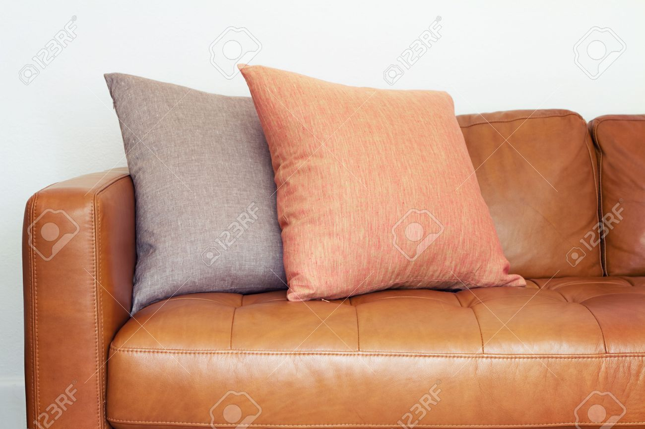 Close Up Of Tan Leather Sofa With Two Linen Cushions Stock Photo Picture And Royalty Free Image Image 36269996