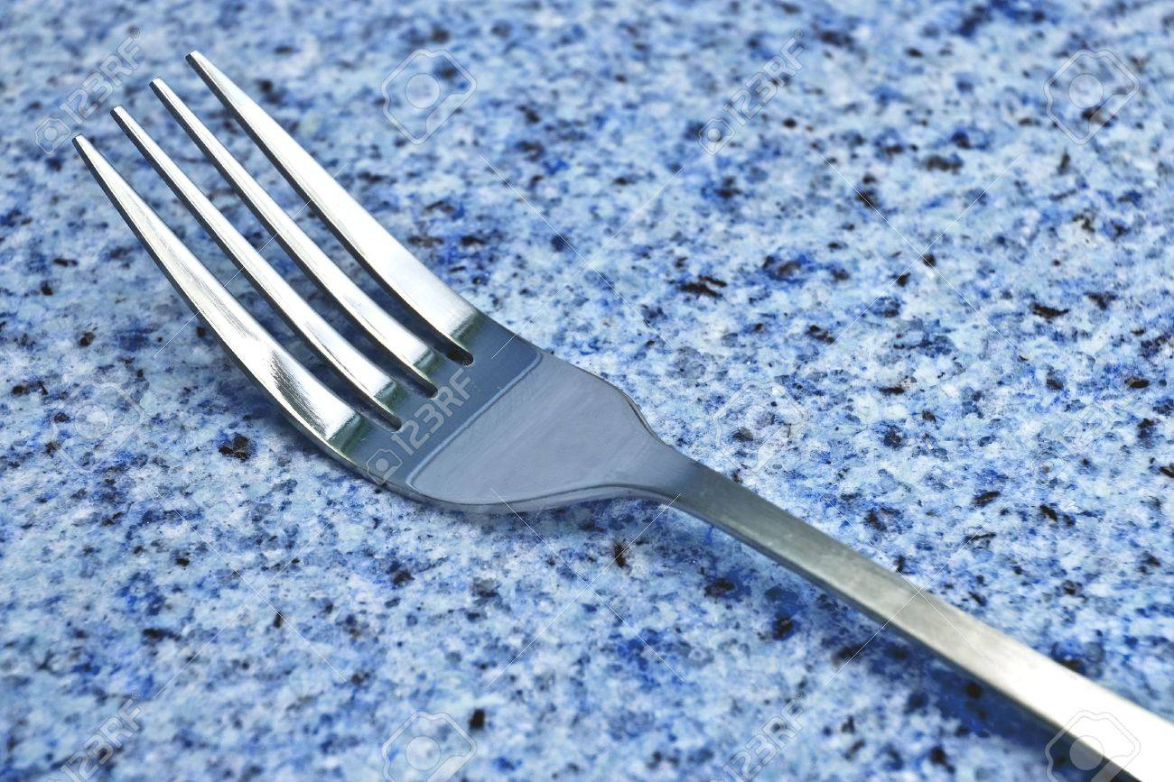 Arbeitsplatte Blau Silver Fork On Blue Granite Countertop