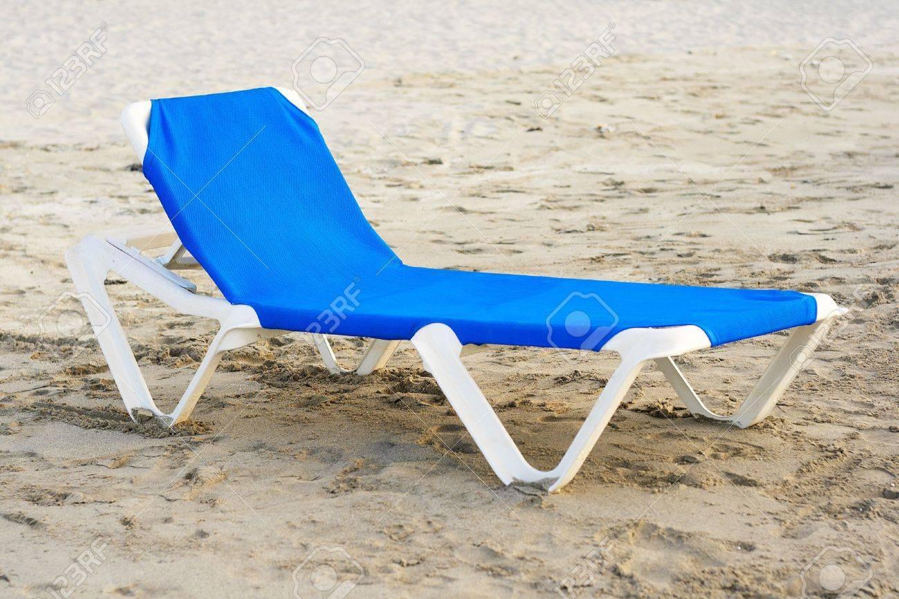 Blue plastic beach chair in a deserted beach stock photo 5559556