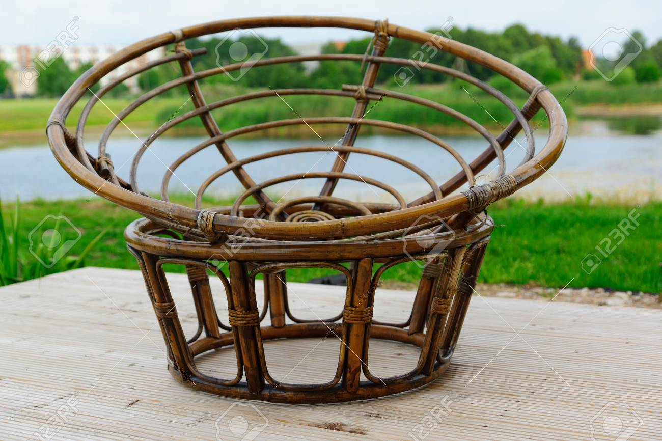 Bank Rattan The Chair Weaved From Rods Of A Rattan Is On The Bank Of The