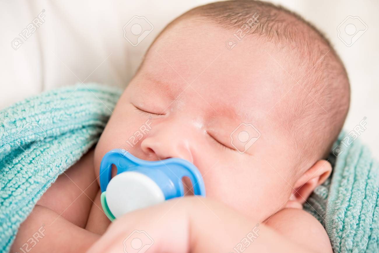 Newborn Babies For Dummies Adorable Sleeping Newborn Baby With Dummy In The Mouth