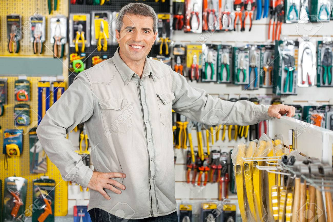 Store En Stock Happy Man Standing In Hardware Store