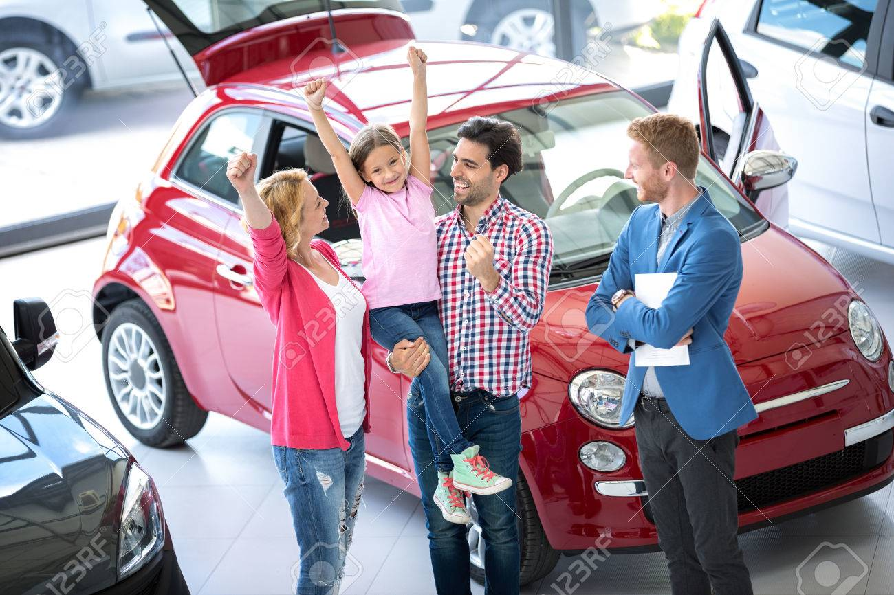 Buying A New Car Happy Family At The Dealer Buying A New Car Excited With Hands