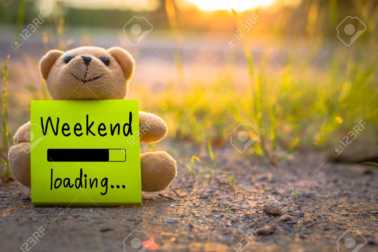 Week End Happy Weekend On Sticky Note With Teddy Bear On Nature Background