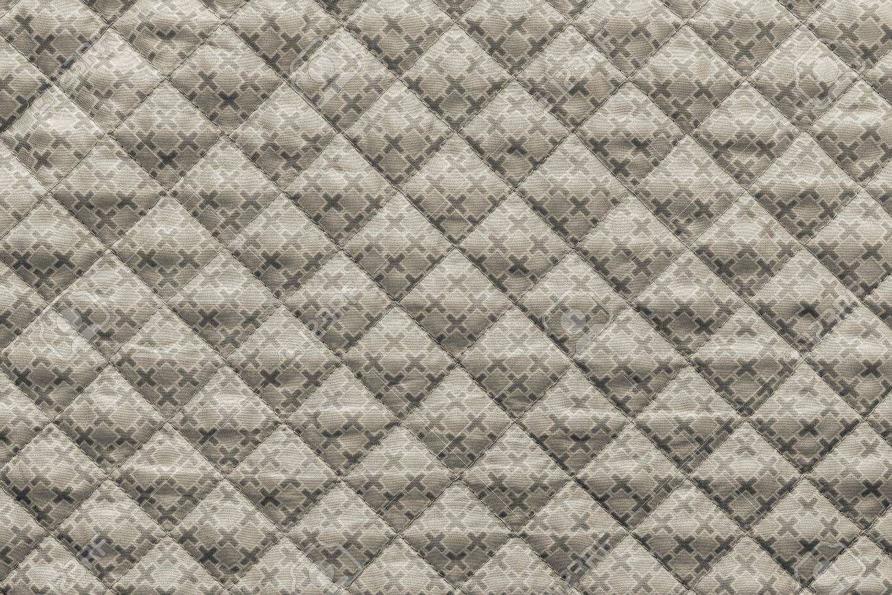 Quilted Fabric Grained Texture Of Beige Quilted Fabric With An Abstract Pattern
