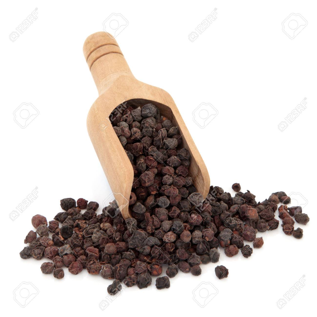 Wu Wei Zi Schisandra Berries Used In Chinese Herbal Medicine In A Wooden