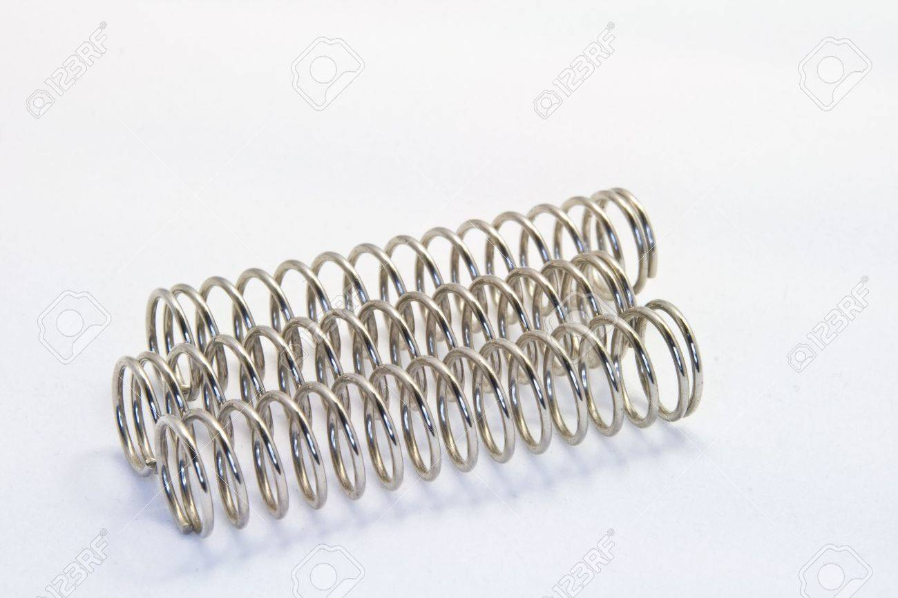 Compression Springs Steel Compression Springs Against A White Background