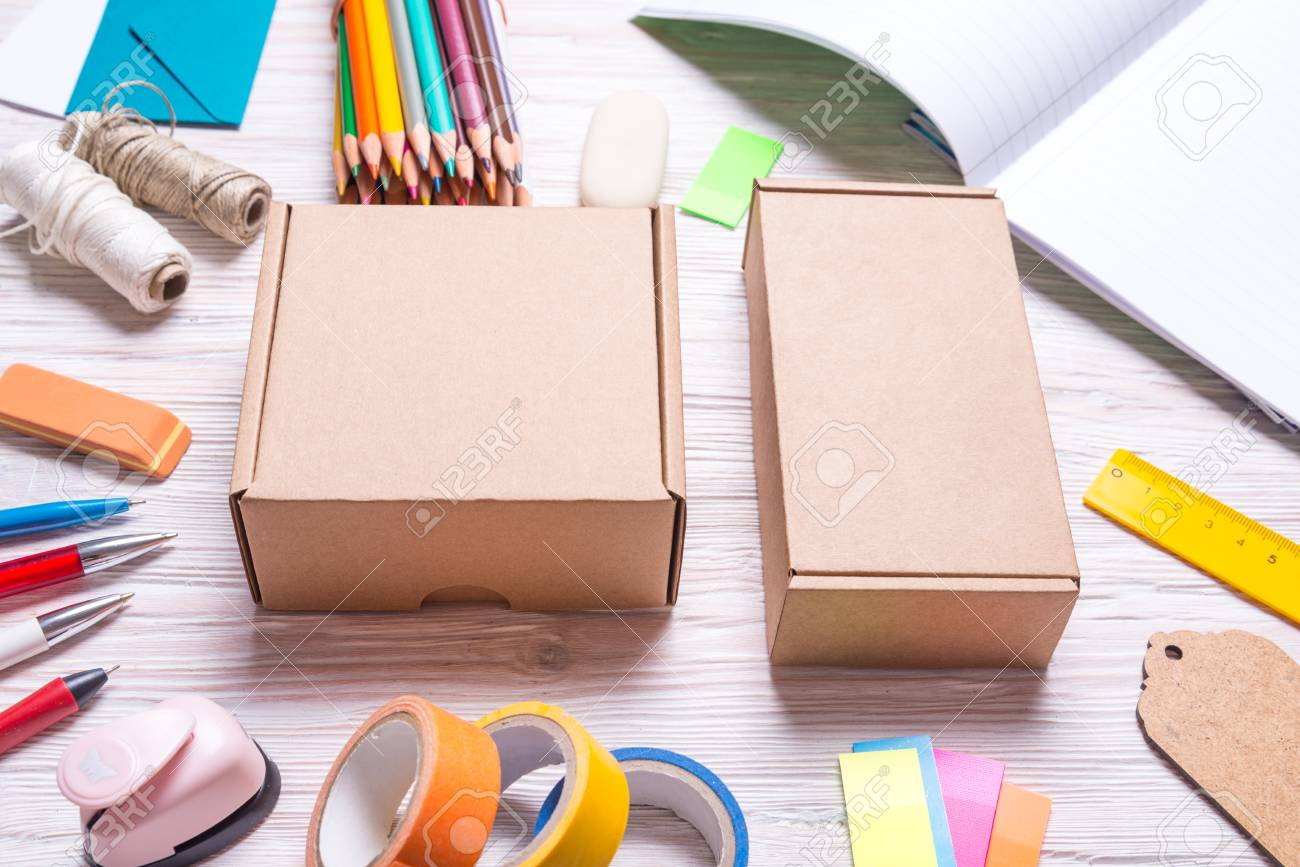 Stationary Boxes Set Of Cardboard Boxes And Stationery On A Wooden Background