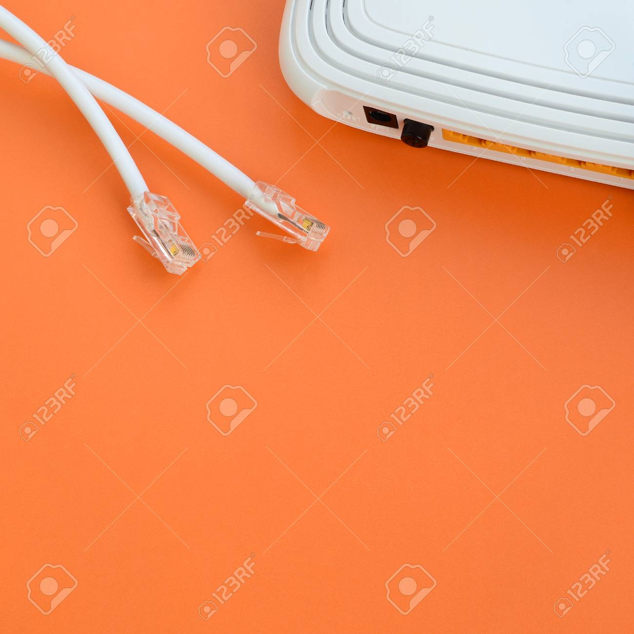 Orange Connexion Internet Internet Router And Internet Cable Plugs Lie On A Bright Orange