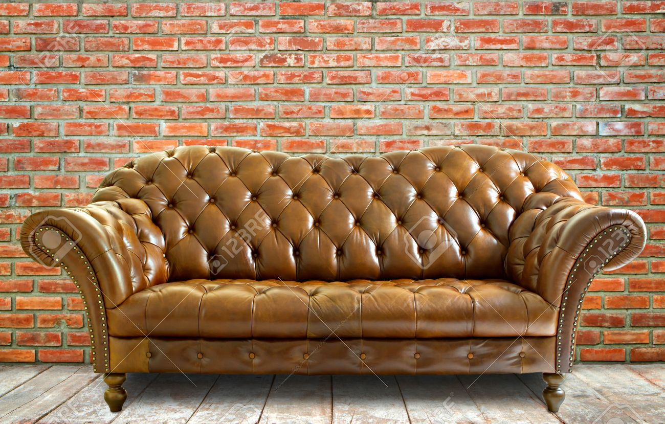 Vintage Ledersofa Vintage Style Leather Sofa With Wooden Floor And Brick Wall