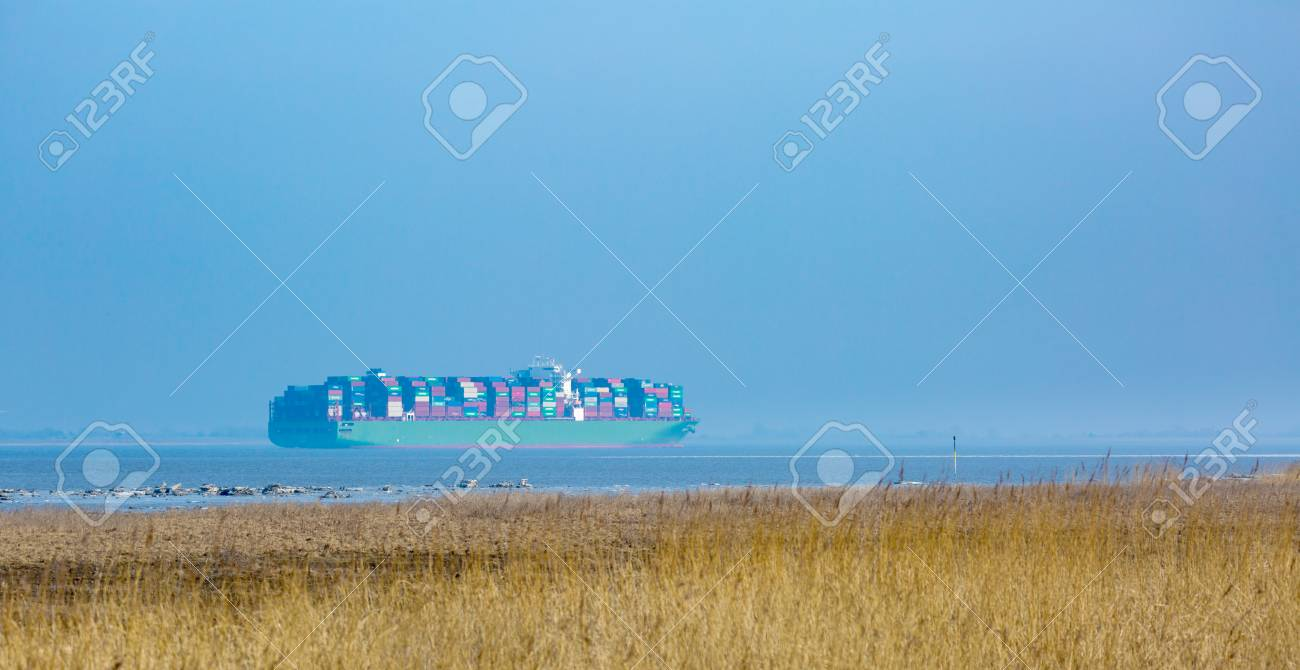 Container Freiburg A Fully Loaded Container Ship Sails On The Elbe River Estuary
