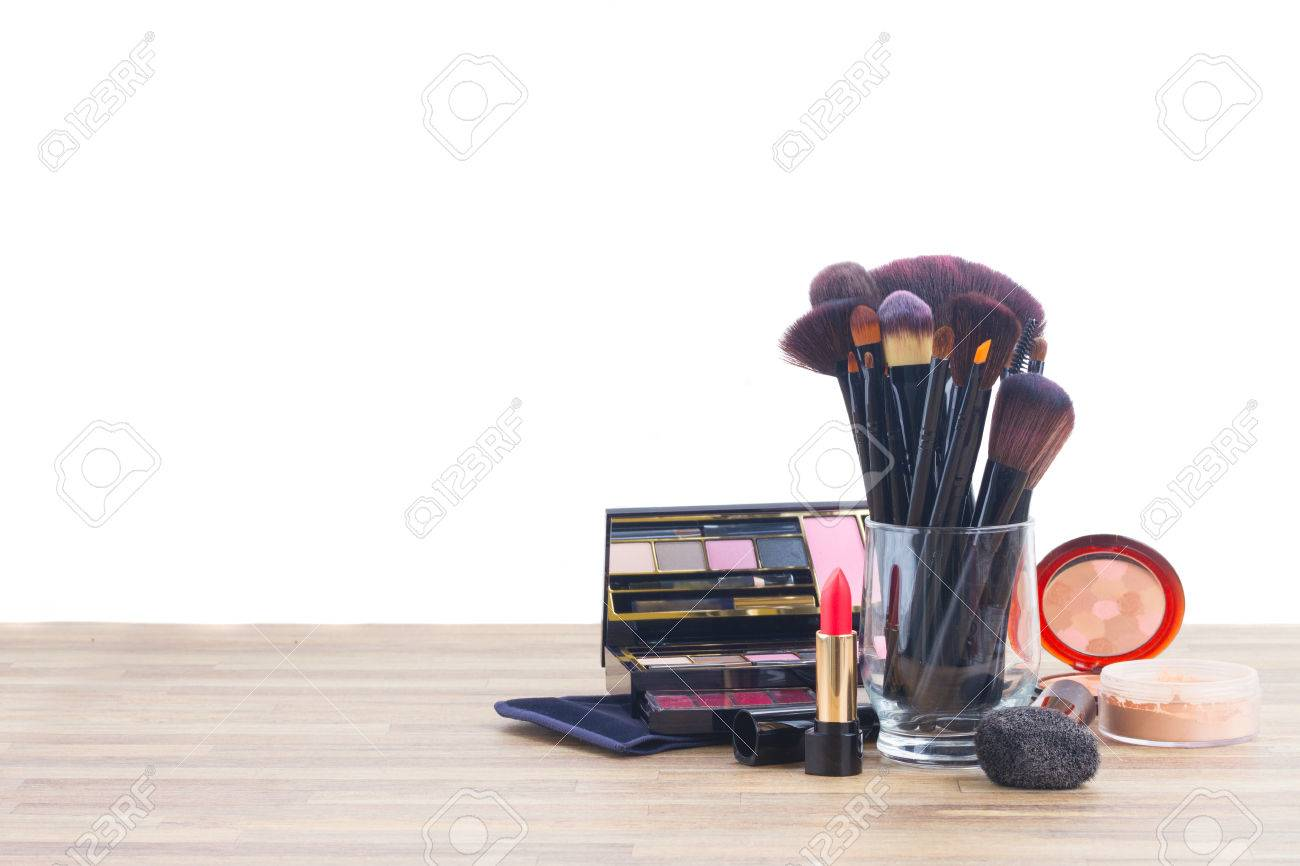 Wooden Make Up Table Glass Can With Brushes And Make Up Products On Wooden Table Border